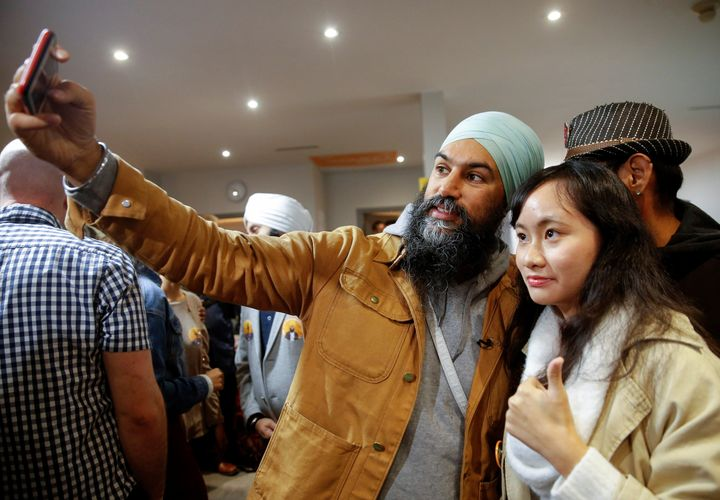 NDP Leader Jagmeet Singh takes a selfie with a supporter at the party election office in Burnaby, B.C. on Oct. 21, 2019.