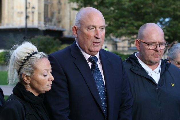 Spokesman Radd Seiger for the family of Harry Dunn, flanked by mother Charlotte Charles and father Tim