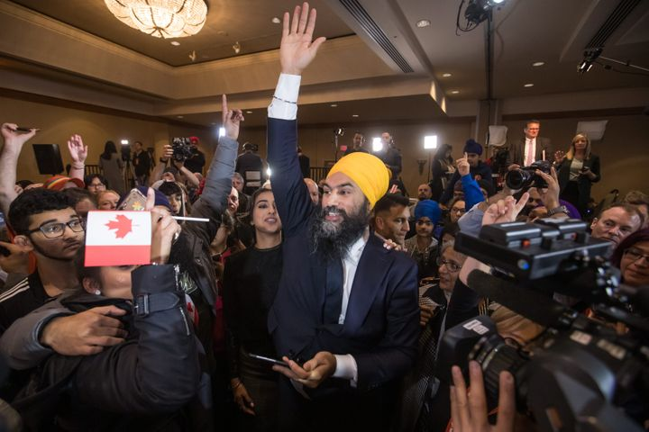 NDP Leader Jagmeet Singh and his wife Gurkiran Kaur Sidhu greet supporters during an election night party in Burnaby, B.C., on Monday October 21, 2019.