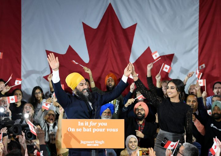 NDP leader Jagmeet Singh and his wife Gurkiran Kaur wave to supporters on stage at NDP election headquarters in Burnaby, B.C. on Monday, Oct. 21, 2019.
