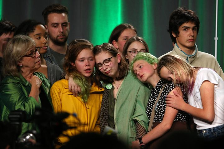Green Party leader Elizabeth May consoles young supporters in Victoria on Oct. 21, 2019.