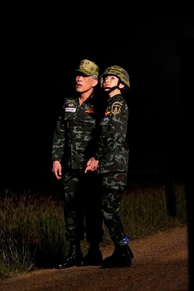 She appeared in a series of unprecedented pictures alongside King Maha Vajiralongkorn and the royal