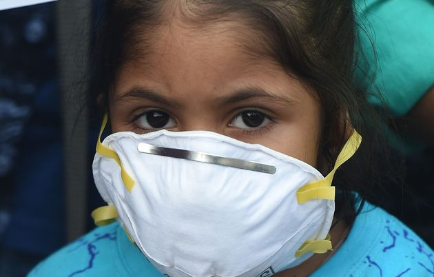 A girl wears a face mask to protect against air pollution in New Delhi on November 6,