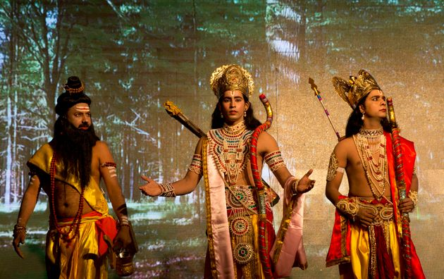 Artists dressed as Rama, center, and his brother Lakshman during a Ramleela play in Allahabad on 21 September,