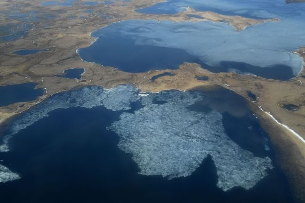 This is an aerial view of melting permafrost tundra and lakes in Alaska's Yukon Delta, as photographed...