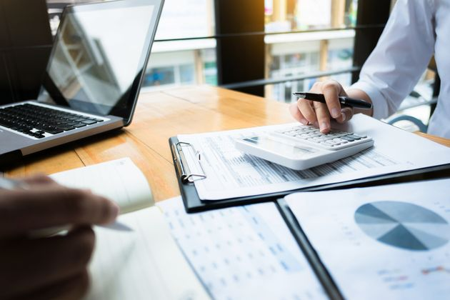 business audits using a calculator financial data investment fund at a workplace, wealth