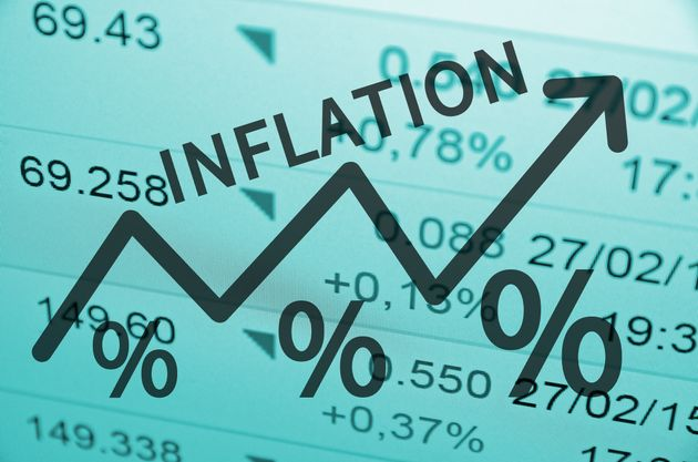Word Inflation on up trend arrow, with financial data visible on the