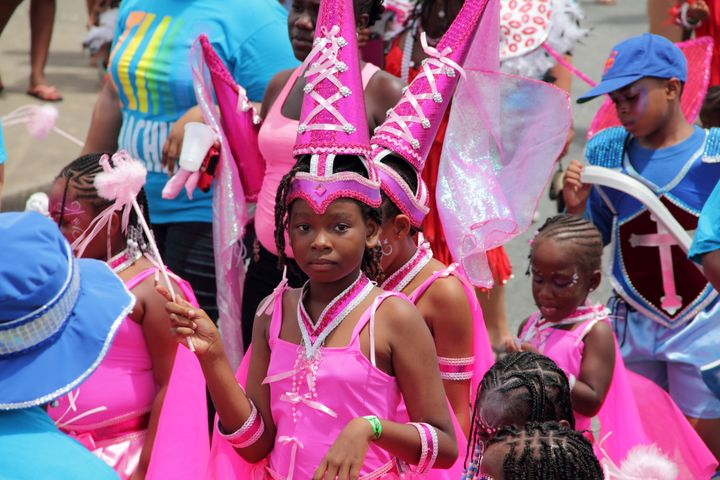 Kids celebrate Crop Over in Barbados in costumes that are considered appropriate for the festival.