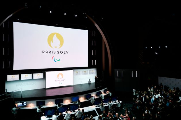 People attend a logo presentation ceremony for Paris 2024 Olympic Games at the Grand Rex cinema in Paris...