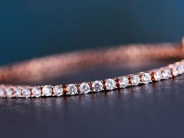 "Step up your jewelry game with this&nbsp;<a href=""https://www.huffpoststuff.com/sales/white-topaz-swarovski-crystal-3mm-classic-round-tennis-bracelet-gold?utm_source=huffpost.com&amp;utm_medium=referral&amp;utm_campaign=white-topaz-swarovski-crystal-3mm-classic-round-tennis-bracelet-gold&amp;utm_term=scsf-345974&amp;utm_content=a0x1P000004MqL4&amp;scsonar=1"" target=""_blank"" rel=""noopener noreferrer"">Swarovski crystal classic round tennis bracelet</a>, which is only $20."