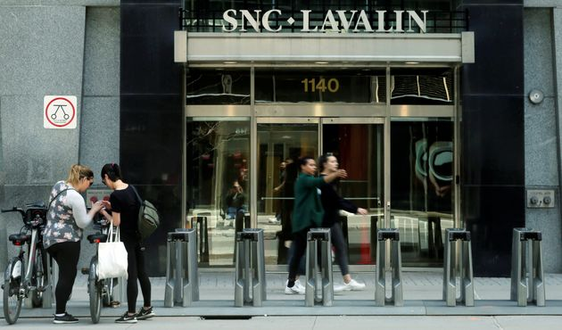 Pedestrians walk past the SNC-Lavalin building in Montreal, May 5,