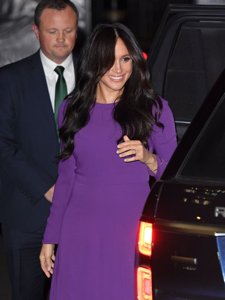 Meghan attended the ceremony in a stunning purple dress.