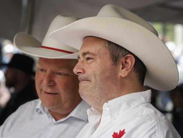 Premiers Jason Kenney, right, of Alberta, and Doug Ford, of Ontario, attend the Premier's Stampede Breakfast...