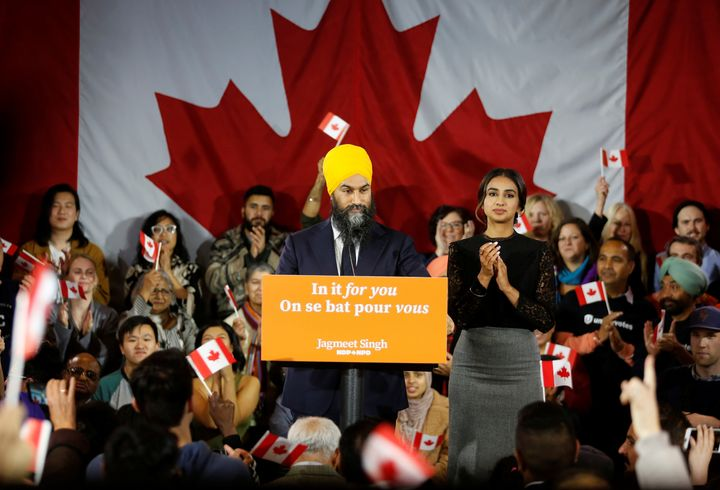 Jagmeet Singh speaks to supporters besides wife Gurkiran Kaur Sidhu in Burnaby, B.C. on Oct. 21, 2019.