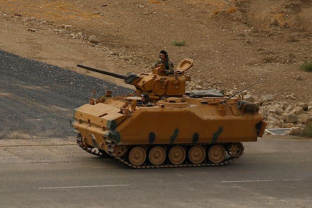 Un soldat turc le long de la frontière turco-syrienne le 22 octobre. Le jour même, la Turquie...