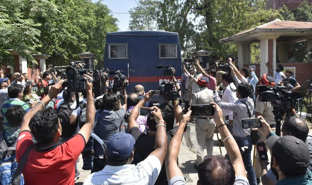 The accused are brought to the district court complex in a police bus on June 10, 2019 in Pathankot,