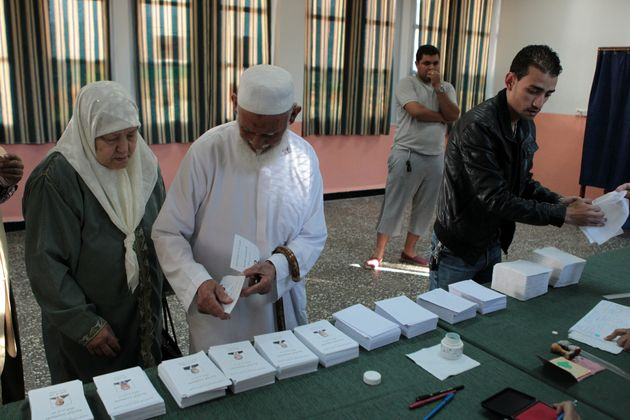 An Algerian woman do his duty casts her ballot at a polling centre in Algeirs on April 17, 2014 in Algeria's...