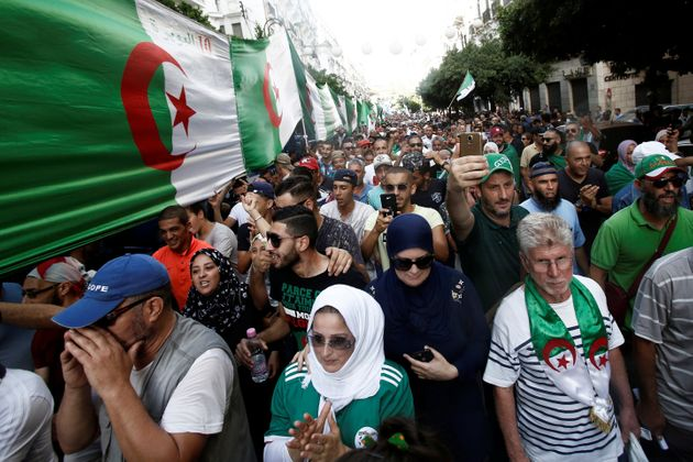 Demonstrators shout slogans during a protest against the country's ruling elite and rejecting a December...