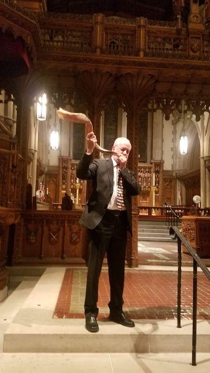 Rabbi Jeffrey Myers blowing the shofar the week before Rosh Hashanah inside of Calvary Church, the Episcopal Church that host
