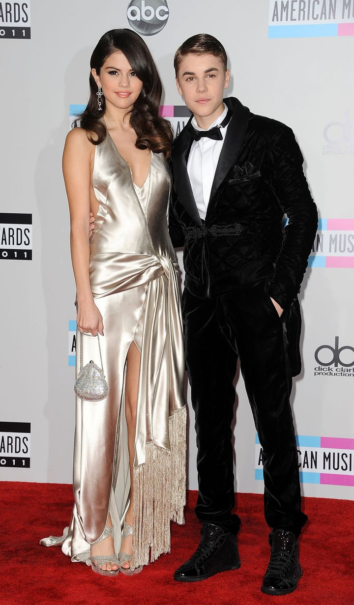 Selena Gomez and Justin Bieber arrive at the 2011 American Music Awards.