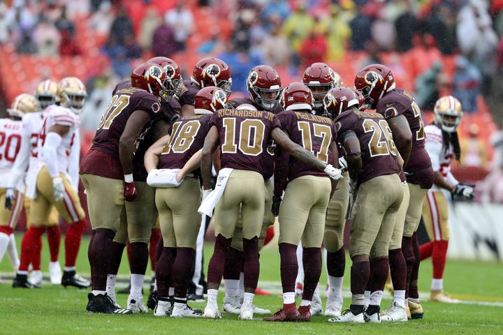 The Washington football team's offense huddles during a game against the San Francisco 49ers at FedExField on October 20, 201