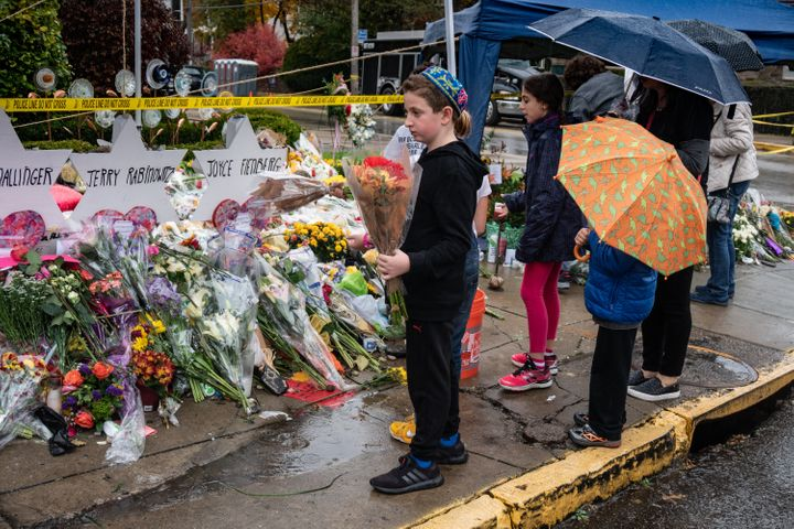 Children pay their respects at a memorial site outside the Tree of Life synagogue in Pittsburgh on Oct. 31, 2018.