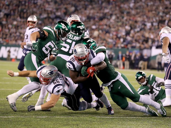 Sony Michel #26 of the New England Patriots rushes for his second touchdown in the first quarter against the New York Jets du
