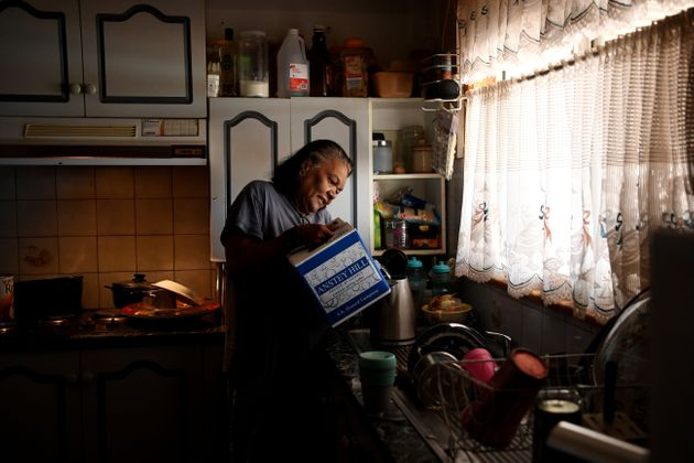 Barkindji elder Patricia Doyle uses boxed water to make a cup of tea at her home in Menindee, New South...