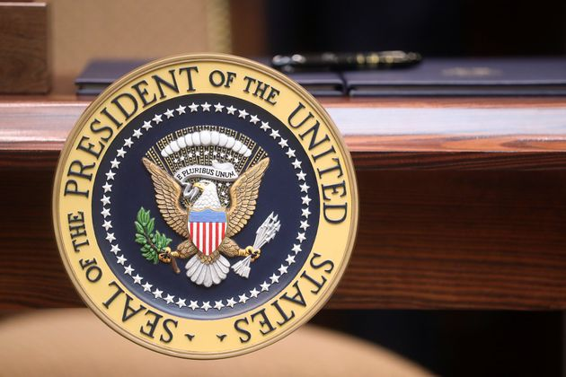 An executive order sits atop a desk adorned with the presidential seal prior to U.S. President Donald...