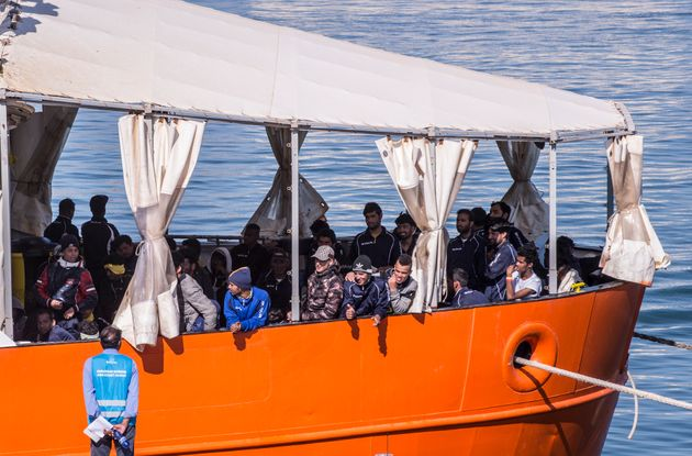 CATANIA, ITALY - MAY 10: Migrants wait to disembark The ONG Aquarius at the Port of Catania on May 10,...