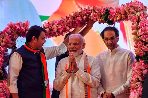 Prime Minister Narendra Modi with Shiv Sena chief Uddhav Thackeray and Maharashtra Chief Minister Devendra...