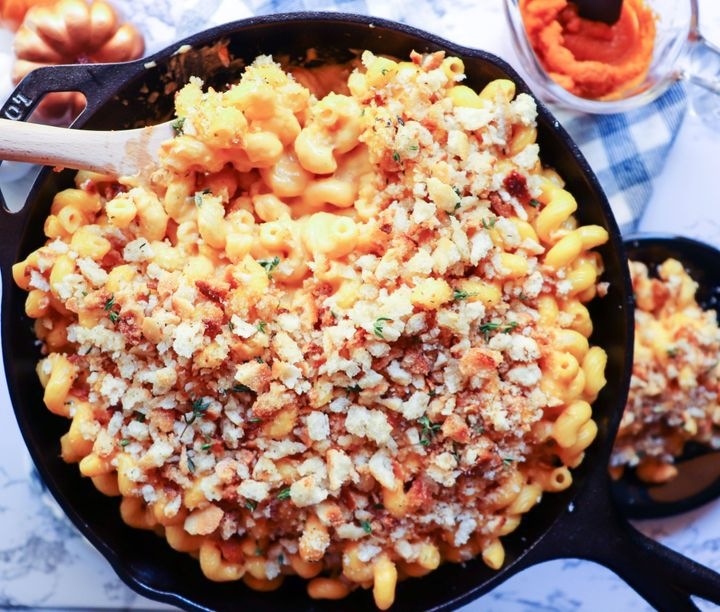 """<strong><a href=""""https://www.huffpost.com/entry/pumpkin-mac-and-cheese_l_5db1c141e4b0131fa99afeab"""" target=""""_blank"""" rel=""""noopener noreferrer"""">Get the recipe for Smoked Gouda Pumpkin Mac and Cheese.</a></strong>"""