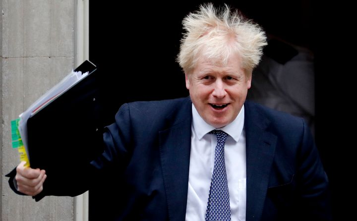 Britain's Prime Boris Johnson leaves 10 Downing Street to attend the weekly Prime Ministers' Questions in Parliament in London on Wednesday.