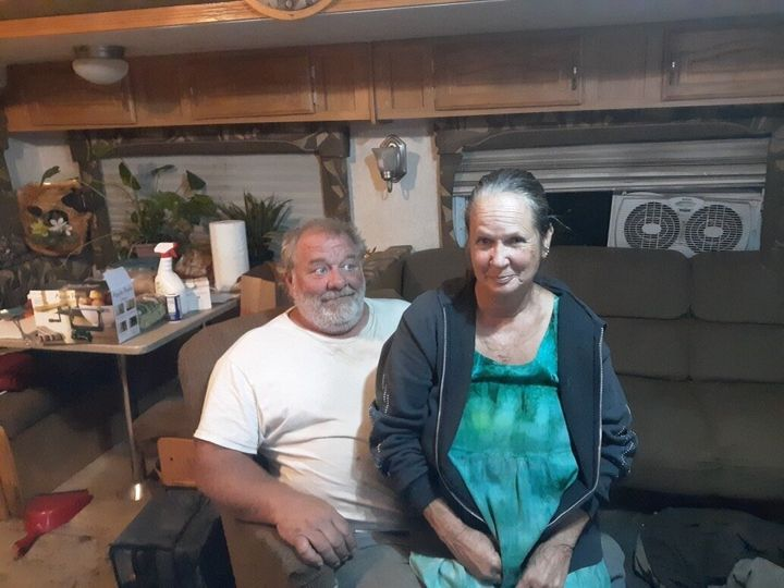 Therese and John Rubiolo sit in a trailer in Concow, California, where they've been living since the Camp fire destroyed thei