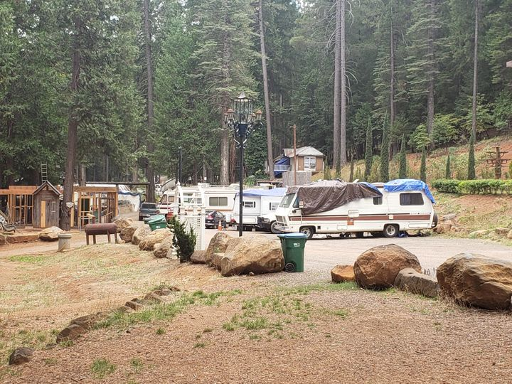 Trailers and RVs line up where Camp fire survivors are living in Nimshew Park in Magalia, California.