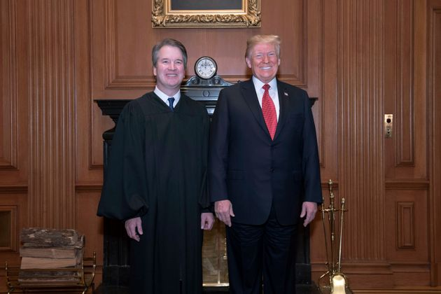 In this image provided by the Supreme Court, President Donald Trump poses with Associate Justice Brett...