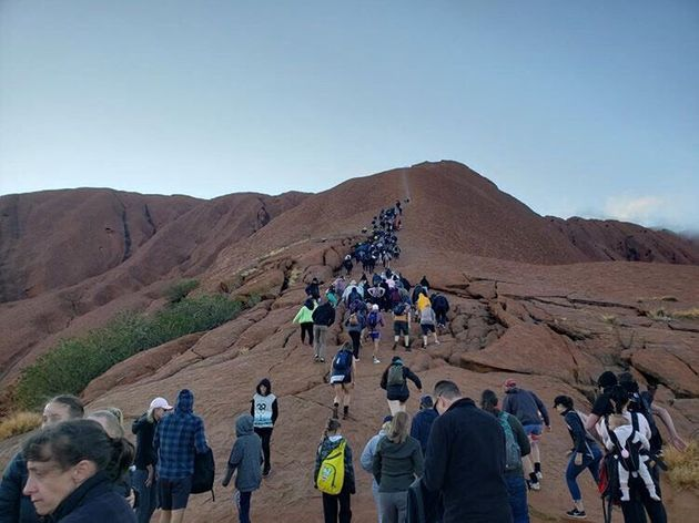 Tourists crowd a trail as they attempt to climb the