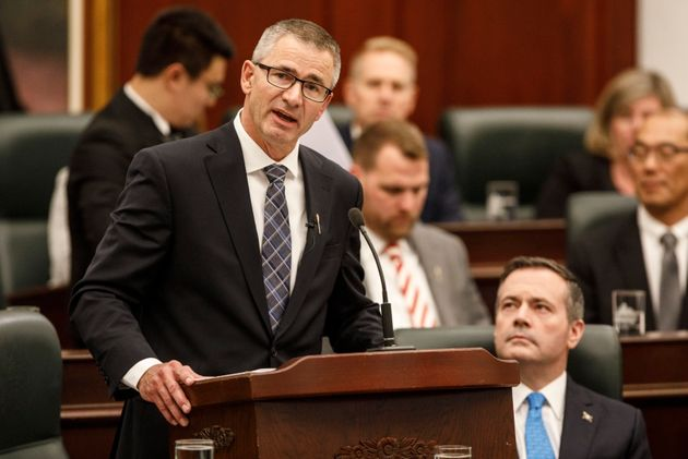Finance Minister Travis Toews, left, delivers the provincial budget as Alberta Premier Jason Kenney looks...