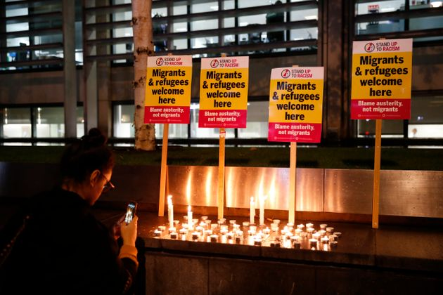 Anti-racism campaigners attend a vigil outside the Home Office in Westminster, London, for the 39 people...