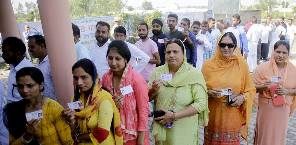 Panches and Sarpanches stand in a queue to cast their vote for Block Development Council (BDC) election,...