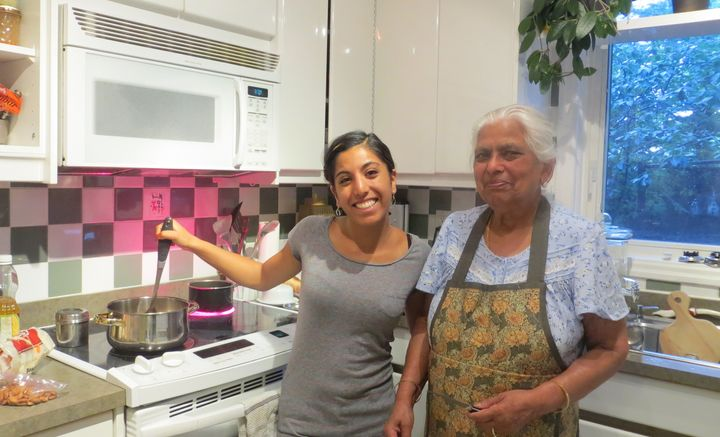 The author attempts to learn to cook Indian food from her nani (maternal grandmother), right.