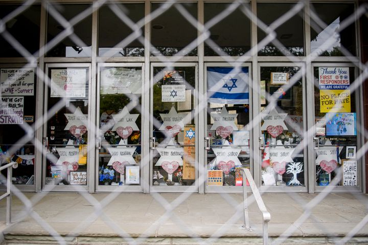 Signs and memorial wishes on the doors of Tree Of Life Synagogue on August 7, 2019, in Pittsburgh, Pennsylvania.