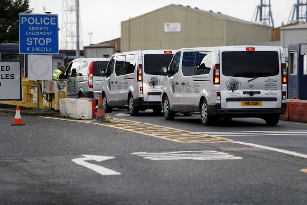 Private ambulances arrive at the Port of Tilbury to transport the remains of the 39 people found dead...