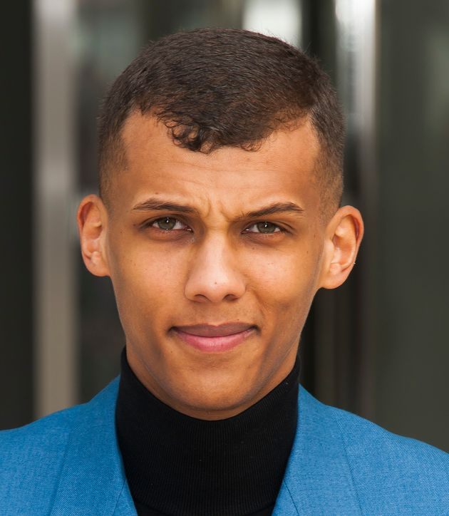 Stromae arriving for the Louis Vuitton Fall/Winter 2015-2016 Ready-To-Wear collection show held at Fondation...