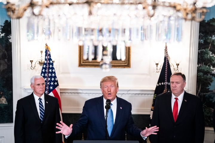 President Donald Trump, flanked by Vice President Mike Pence and Secretary of State Mike Pompeo, announces that the U.S. will