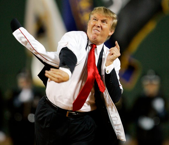Donald Trump throws out the ceremonial first pitch before the start of the game between the Boston Red Sox and the New York Yankees in the second game of a day/night doubleheader on Aug. 18, 2006, at Fenway Park in Boston.