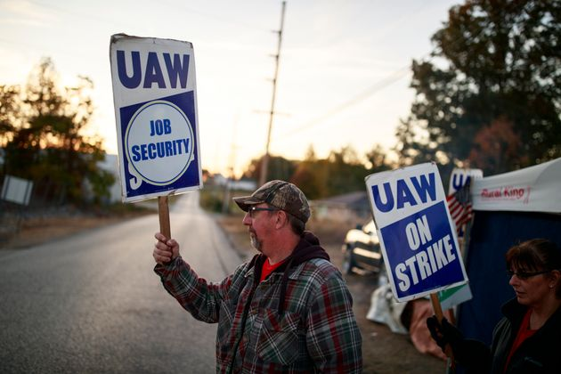 United Auto Workers members picket outside the Bedford Casting Operations plant in Bedford, Indiana,...