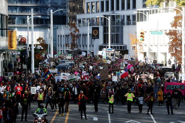 Climate activists march during a climate rally in Vancouver on