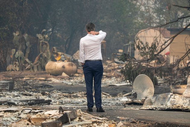 Gov. Gavin Newsom surveys a home destroyed in the Kincade fire on Oct. 25, 2019, in Geyserville,