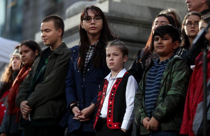 Some of the 15 young people who are parties to a lawsuit filed against the federal government for contributing to high levels of greenhouse gas emissions and dangerous climate change are seen at a press conference, in Vancouver on Friday.